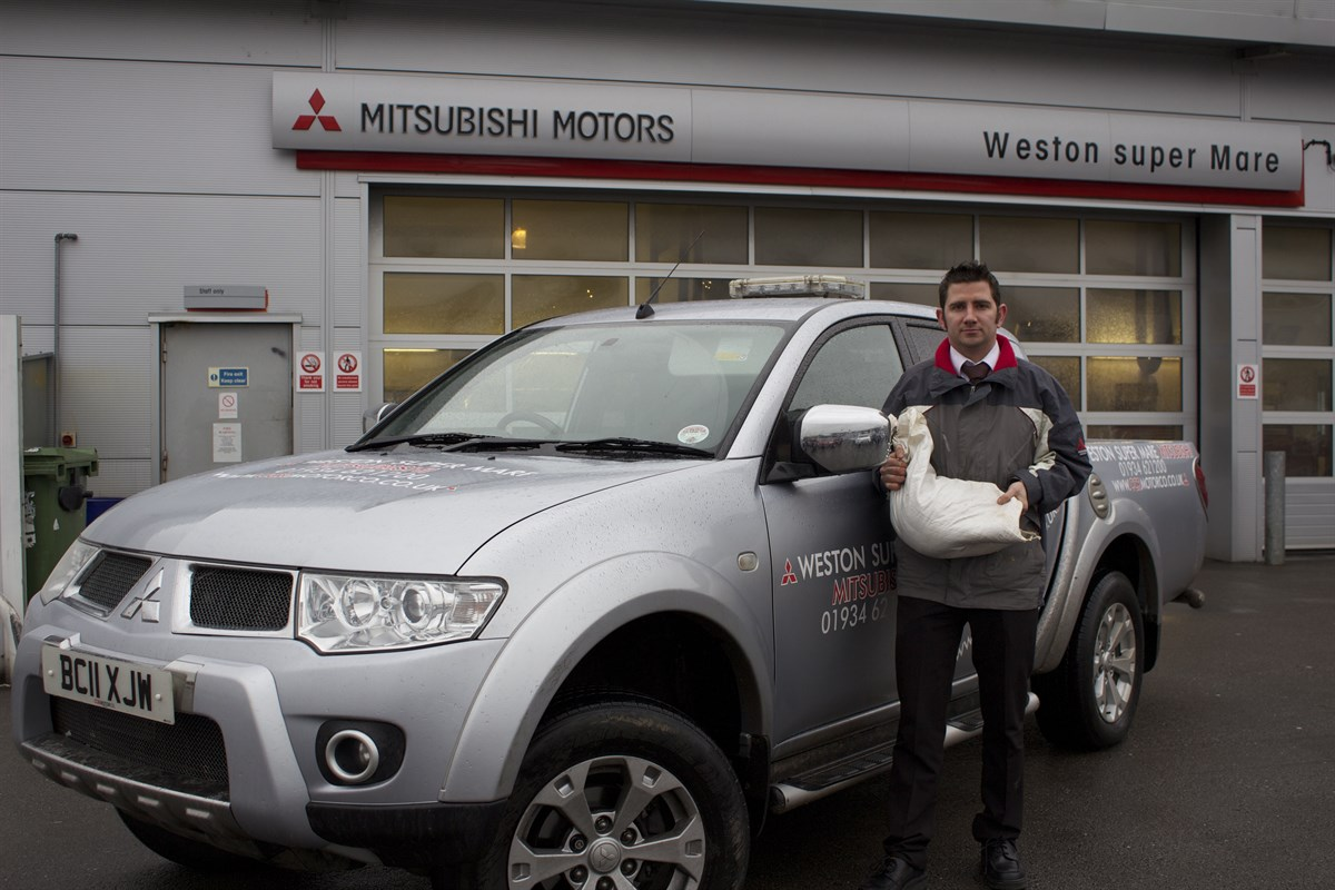 mitsubishi dealer helps somerset flood victims car dealer news. Black Bedroom Furniture Sets. Home Design Ideas