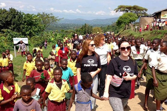 Peter Vardy partners on a charity work trip to Uganda where they met some of the children they sponsor