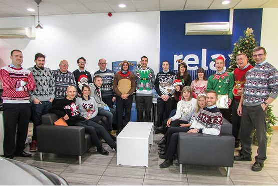 Premier Ford staff members raising money  for charity in their Christmas jumpers