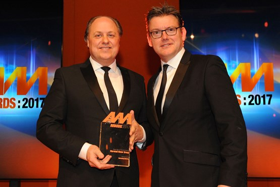 Philip J Deacon, head of  marketing, Marshall Motor Group, accepts the award for Best Use of Social  Media from Jeremy Evans, managing director, Marketing Delivery
