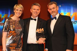Flying high: Paul Philpott, president and chief executive, Kia (centre), collects  Kia recent AM Award 2017 for used car of the year from Philip Morrison, head of corporate sales, Car Care Plan