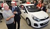 Jennings Motor Group managing director, Nas Khan, hands raffle prize winner Kath Mewse the keys to her new Kia Rio