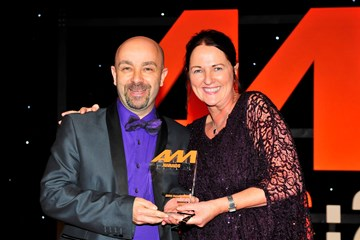 Kevin Davidson, retailer development director, BMW Group UK, accepts the award for  Digital Initiative of the Year from Sharon Randall, UK sales director, Auto Trader