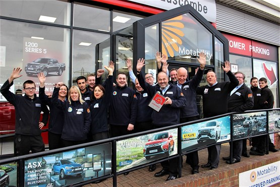 Robin Luscombe and staff at Luscombe Motors celebrate  their AM Best UK Dealerships to Work For award