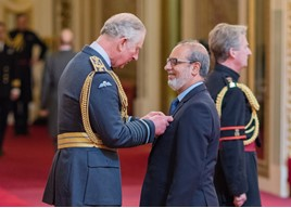 HRH The Prince of Wales presents Jennings Motor Group's managing director, Nas Khan, with his OBE at Buckingham Palace.