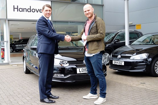 Coldplay drummer Will Champion collecting his Polo from Paul Tanner at Alan Day Volkswagen