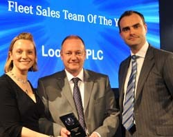 Nigel Barber, corporate fleet director for Lookers Mercedes-Benz, middle, collects the award for Fleet Sales Team of the Year from Mercedes-Benz UK sales director Mike Whittington and awards host Vicki Butler-Henderson