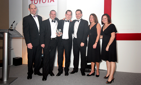 Michael Cole, sales director Toyota (GB) (far left) presents the award to the winning business centre team at Jemca.