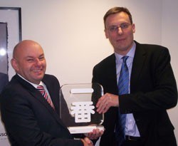 David Lowes recieves the Ichiban award from Jon Williams, commercial director at Toyota GB