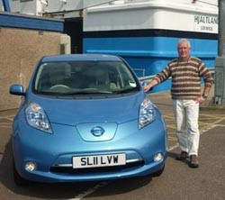 Jim Dickson and his new Nissan Leaf at Aberdeen Harbour.