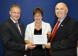 Jo Causen, chief executive of ICS, presents the Training Mark to Ford Retail CEO Chris Hayden (right) and customer relations director, John Leathem