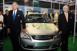 Tata Motors chairman, Ratan Tata and managing director, Ravi Kant, with the electric Indica.
