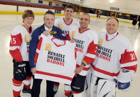 Andy Beach, from Renault Solihull, and players from the team show off the new team strip